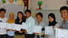 The teachers of Gems International school with their certificates for completing the Reading Roots seminar.